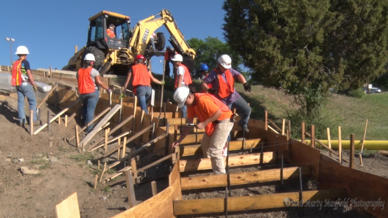 RHS YCC projects are under way at Raton High School. Here, the students are preparing forms for the new stairway from the lower parking lot to the upper parking lot on the north side of the high school. Photo by Marty Mayfield.