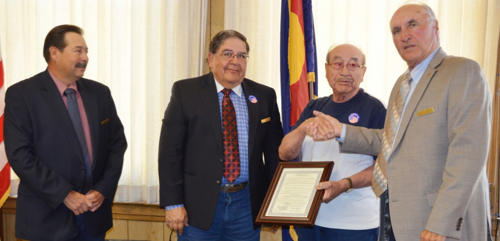 USMC and U.S. Army veteran Dan Cruz was honored for his service to his county by the Huerfano County Commissioners Tuesday. Cruz is pictured third from the left; also shown, commissioners Gerald Cisneros, Ray Garcia, and Max Vezzani. Photos by Eric Mullens