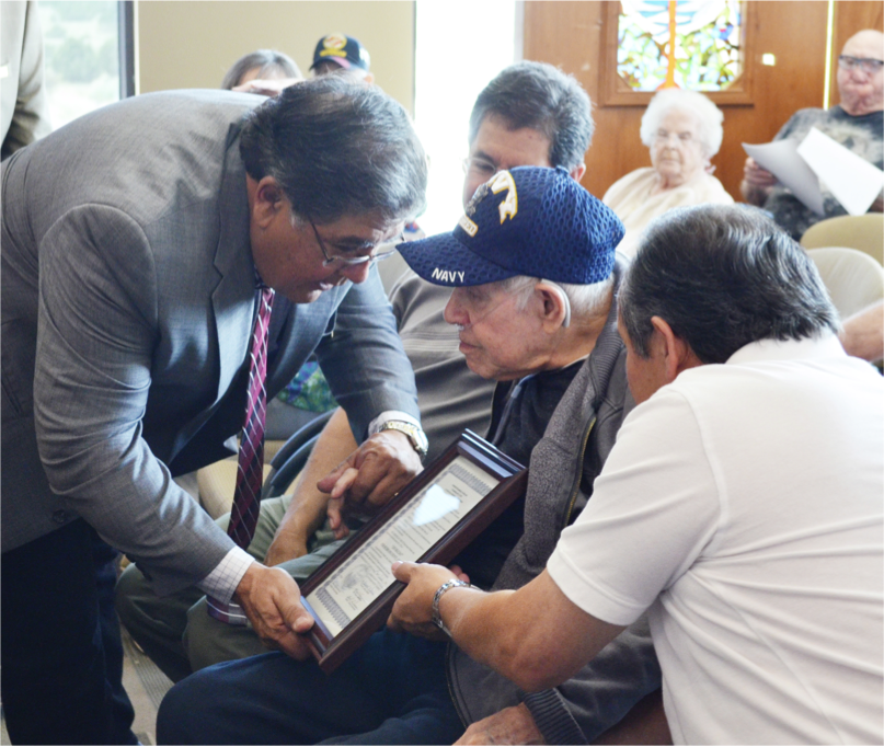 Commissioner Ray Garcia with veteran Leo Diaz