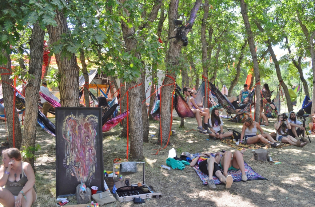 Festival-goers beat  the noon day heat by sacking out in one of many  available hammocks.